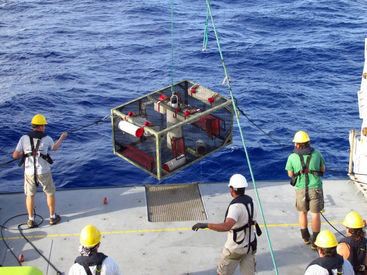 Researchers recover the trap after it landed on the bottom of the Mariana Trench. Credit: UW News