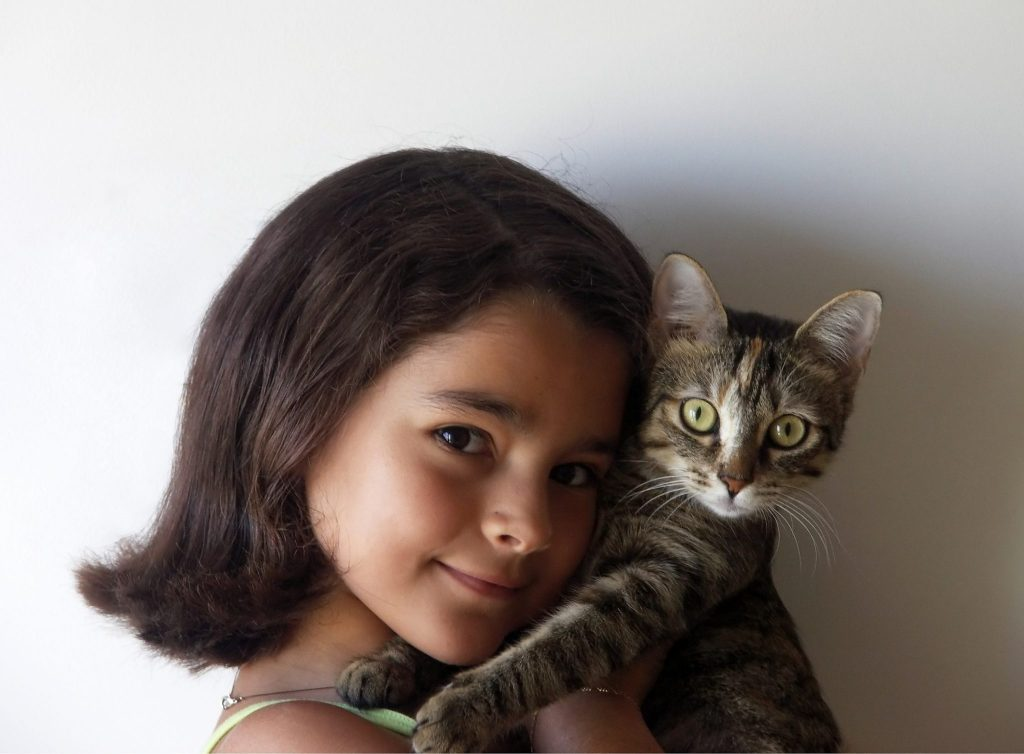 A girl and her kitty. Source: Wikimedia